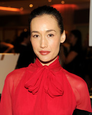 Maggie Q opted for a simple ponytail to complete her Believe Gala look.