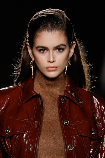 Kaia Gerber Gold Dangle Earrings [hair,fashion model,face,fashion,eyebrow,lip,beauty,hairstyle,skin,lady,versace pre-fall 2019 collection,kaia gerber,versace fall,runway,new york city,the american stock exchange]