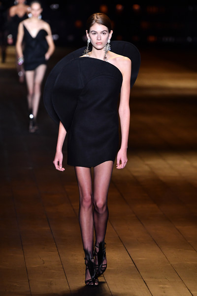 Kaia Gerber One Shoulder Dress [fashion model,fashion,fashion show,clothing,dress,runway,shoulder,little black dress,joint,cocktail dress,kaia gerber,part,runway,paris,france,saint laurent,saint laurent : runway - paris fashion week womenswear fall]