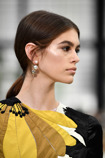 Kaia Gerber Ponytail [hair,hairstyle,fashion model,fashion,yellow,beauty,chin,ear,lip,black hair,valentino,kaia gerber,part,runway,paris,france,valentino : runway - paris fashion week womenswear fall,show]