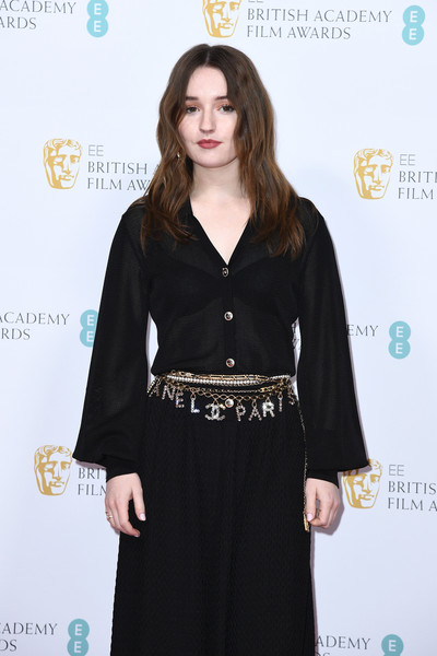Kaitlyn Dever Metallic Belt [clothing,fashion,dress,carpet,sleeve,long hair,a-line,fashion design,neck,waist,british academy film awards 2020 nominees,kaitlyn dever,ee,england,london,kensington palace,red carpet arrivals,party,kaitlyn dever,73rd british academy film awards,royal albert hall,25th critics choice awards,bafta rising star award,red carpet,photography,american film institute awards,celebrity,award]