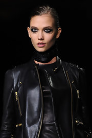 Karlie Kloss walked the runway at the Kanye West fall 2012 ready-to-wear show with heavy, smudged liner and mascara.
