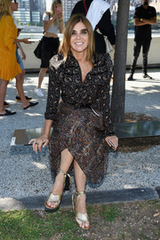Gold ankle-tie sandals pulled Carine Roitfeld's look together.