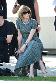 Anna Wintour sat front row at the Yeezy fashion show wearing a teal print dress and the ubiquitous shades.