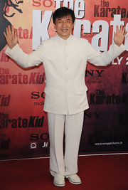 Jackie is all dressed up in his white suit for 'The Karate Kid' premiere in Paris.