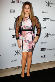 Khloe Kardashian styled her dress with a sheer black cropped jacket for a chicer finish.