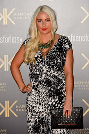 Charlie Hedges accessorized with an edgy and stylish studded black clutch during the Kardashian Kollection for Lipsy launch.