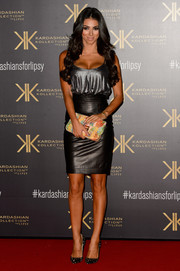 Georgia Salpa showed off her assets in a low-cut silver camisole during the Kardashian Kollection for Lipsy launch.