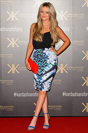 Emily Atack donned a simple yet sexy black camisole for the Kardashian Kollection for Lipsy launch.