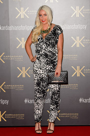 Charlie Hedges looked breezy yet chic in a black-and-white jumpsuit during the Kardashian Kollection for Lipsy launch.