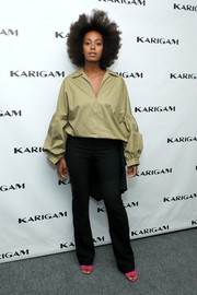 Black slacks with tailcoat-like detailing completed Solange Knowles' attire.