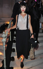 Delphine Chaneac arrived at the Karl Lagerfeld exhibit launch wearing wide leg pants with suspenders.