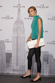Karlie Kloss wore a luxurious turquoise rabbit-fur top by Coach when she attended the label's boutique opening in Madrid.