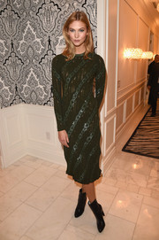 Karlie Kloss hosted the L'Oreal Paris TIFF kickoff reception wearing a chain-patterned forest-green sweater dress by Louis Vuitton.