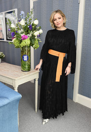 Kate Hudson cut a stylish figure in a black maxi dress with an orange obi belt while attending a WW event.