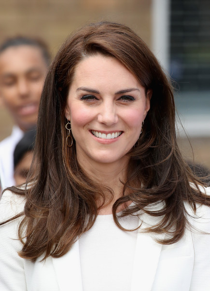 Kate Middleton Gold Dangle Earrings [hair,face,hairstyle,eyebrow,brown hair,long hair,beauty,layered hair,skin,chin,duchess of cambridge,catherine,patron,attends,duchess,roadshow,cambridge,trust roadshow,trust,docklands sailing and watersports centre]