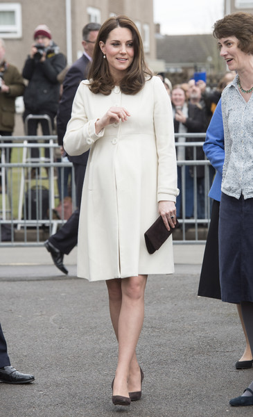 Kate Middleton Pumps [clothing,white,street fashion,fashion,lady,dress,snapshot,footwear,coat,outerwear,duchess of cambridge,children,catherine,family links,duchess,work,wellbeing,cambridge,schools,charity]