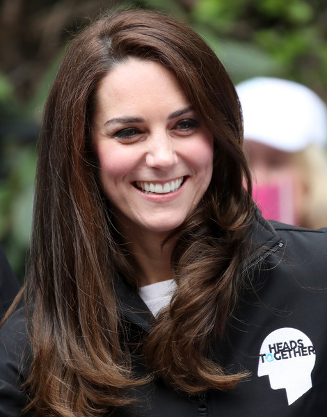 Kate Middleton Long Side Part [hair,face,hairstyle,brown hair,long hair,beauty,smile,eyebrow,layered hair,lady,harry,runners,catherine,duchess,cheers,water,cambridge,britain,the duke duchess of cambridge,the virgin money london marathon]