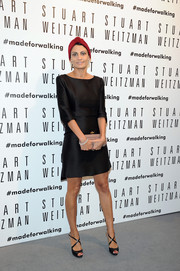 Giovanna Battaglia paired her LBD with stylish black cross-strap peep-toes.
