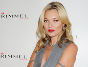 Kate Moss wore one of the shades from her new lipstick collection to a Rimmel photo call. Her bright, cheery red lips were a standout.
