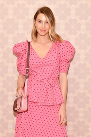 Whitney Port arrived for the Kate Spade Spring 2019 show carrying a two-tone shoulder bag.