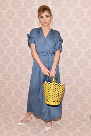 Suki Waterhouse went the ladylike route in a blue maxi wrap dress by Kate Spade during the brand's Spring 2019 show.