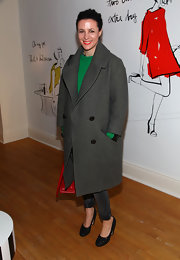 Garance Dore kept warm in an oversized evening coat at a Kate Spade event in New York.