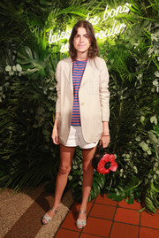 Underneath her jacket, Leandra Medine was casual in white shorts and a striped shirt.