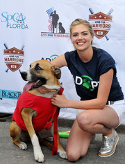 Kate Upton attended the Grand Slam Adoption event wearing a cool pair of silver Grenson oxfords.