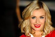 Katherine Jenkins kept her look bright while signing copies of her latest album in London. She matched her cherry red top with some very cherry lips.