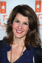 Nia Vardalos added a pop of color to her look with shiny red lipstick.