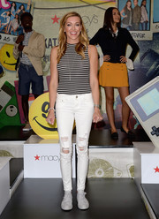 Katie Cassidy went grunge-chic on the bottom half in a pair of ripped jeans.