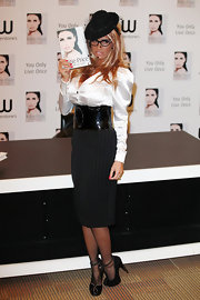 Katie Price looked relatively demure in a pair of embellished black pumps. The platforms were deceptively tall and lined in gemstones.