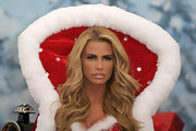 Katie Price made up her pout in a pearly peach-beige lipstick at a photocall for her new book 'Santa Baby.'
