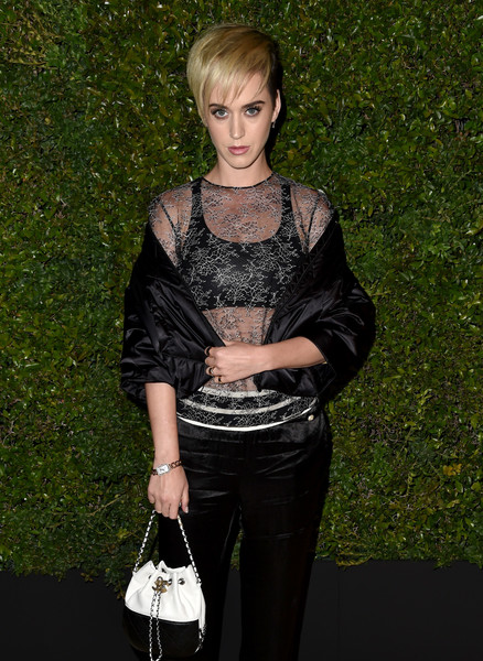 Katy Perry Gold Bracelet Watch [clothing,fashion,blond,outerwear,dress,photography,jacket,fashion accessory,blouse,style,caroline de maigret,pharrell williams,katy perry,gabrielle bag,giorgio baldi,santa monica,california,host a dinner in celebration of chanel,celebration]