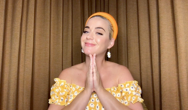 Katy Perry topped off her look with a chunky orange headband.
