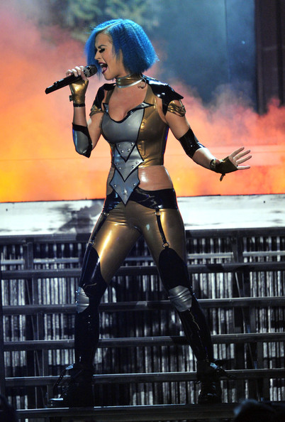 Katy Perry Jumpsuit [katy perry,performance,stage,performing arts,cg artwork,event,fictional character,latex clothing,costume,performance art,thigh,54th annual grammy awards,show,california,los angeles,staples center]