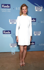 Brooklyn Decker kept it modest in a long-sleeve white maternity dress at the Keds + Lola Women's Equality Day celebration.