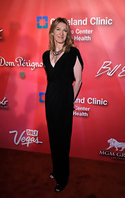 Sticking to a sophisticated silhouette, Steffi Graf's sleek black gown couldn't look more chic.
