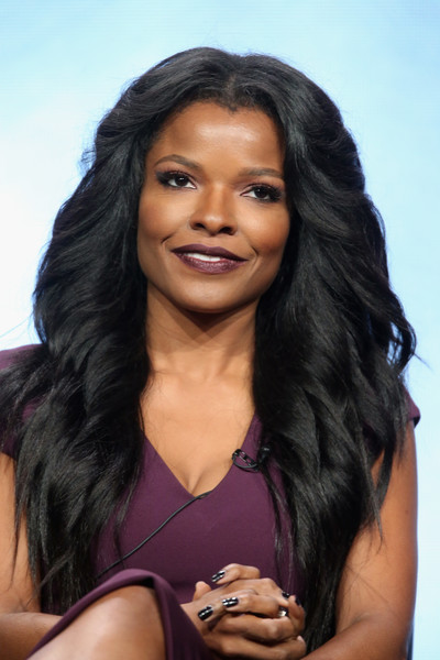 Keesha Sharp Feathered Flip