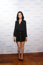 Leigh Lezark chose a black suede mini skirt to complete her outfit.