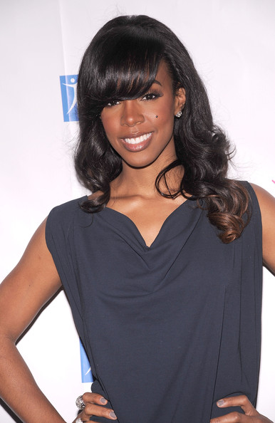 Kelly Rowland Long Curls with Bangs [hair,hairstyle,clothing,black hair,shoulder,long hair,human,cocktail dress,layered hair,bangs,kelly rowland,city of hope-east end chapter 2010 spirit of life award,city of hope-east end chapter 2010 spirit of life award luncheon,grand ballroom,new york city,waldorf astoria,luncheon]