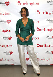 Kelly Rowland looked effortlessly stylish in an emerald-green wrap top by Vivian Chan while attending a WomenHeart and Burlington event.