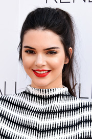 Kendall Jenner attended the launch of the Kendall + Kylie fashion line wearing her hair in an edgy ponytail.