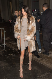 Kendall Jenner added extra oomph with a pair of knee-high gladiator heels by Kendall + Kylie.