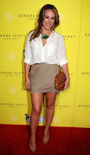 Haylie Duff kept her effortlessly chic red carpet look different at the grand opening of Kendra Scott Jewelry with a bronze leather football clutch.