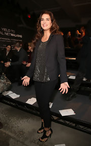 Brooke Shields looked fabulous at the front row of Kenneth Cole in this sharp black blazer and blousy metallic top.