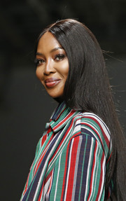 Naomi Campbell sported her signature long straight style at the Kenneth Ize runway show.
