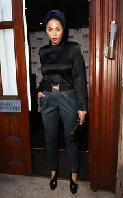 Ana Araujo went for a modest look with a long-sleeve black blouse, slacks, and pumps at the Kensington Club.