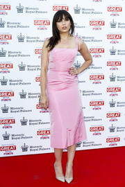 Daisy Lowe cut a sweet figure at the Kensington Palace Summer Gala in a pink dress with bowed spaghetti straps from The Vampire's Wife.
